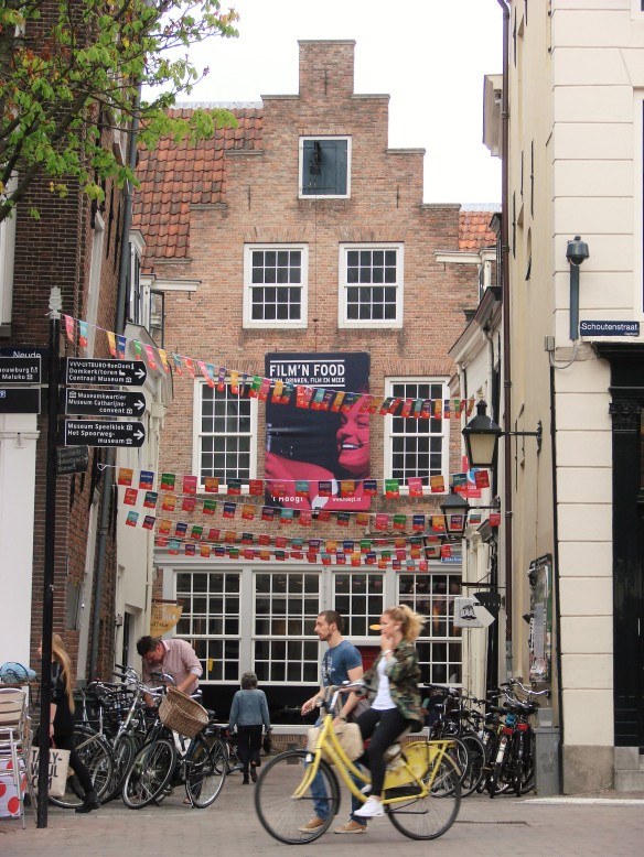 an art film house in utrecht with tour de france banners and regular cyclists